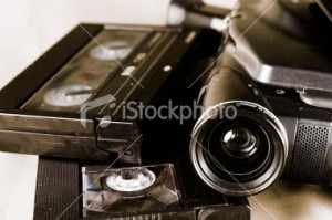 stock-photo-9828962-camera-and-cassettes